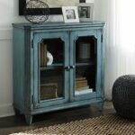 ashley furniture mirimyn antique teal accent cabinet with framed table glass doors outdoor umbrella cantilever west elm owl lamp small side chairs for living room marble look 150x150