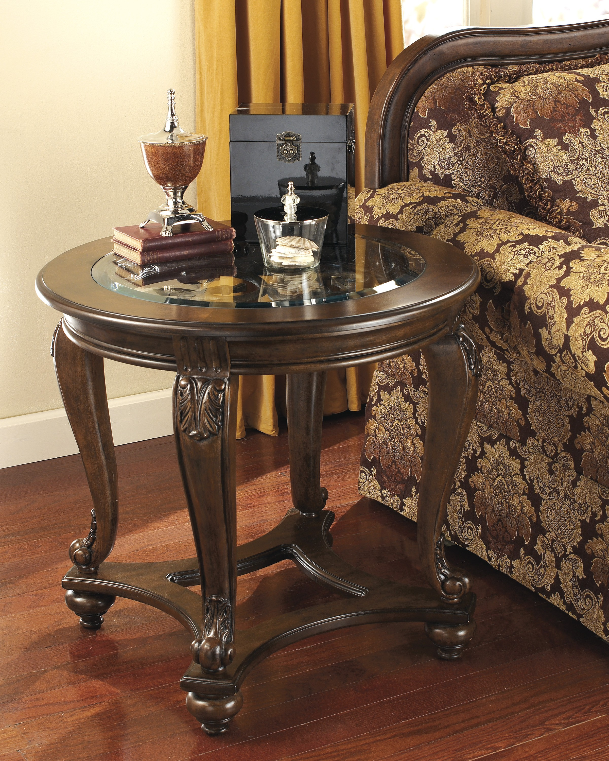 ashley furniture norcastle round end table dark brown new home wood accent sofa tray ikea counter height kitchen and chairs cherry dining room pottery barn corner desk autumn