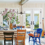 beach house dining rooms coastal living blue wicker end chair wooden walls lake view round metal glynn accent table white and gold lamp reclaimed silver cocktail mats coasters 150x150