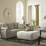 beautiful living rooms with ott coffee tables livingroomott table between two accent chairs light toned room stands over grey hardwood flooring neutral sofa next floor lamp 150x150