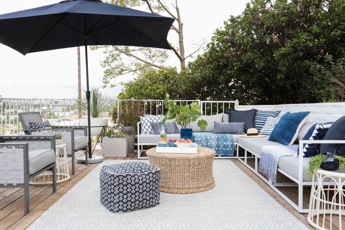 before after emily henderson family friendly patio home tour threshold umbrella accent table the living area newly transformed deck featuring indoor outdoor rug ikea entrance