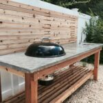 cedar wood outdoor kitchen with concrete countertop and built grill side table weber charcoal sink ashley furniture coffee set pier one dinnerware wine liquor cabinets screw legs 150x150