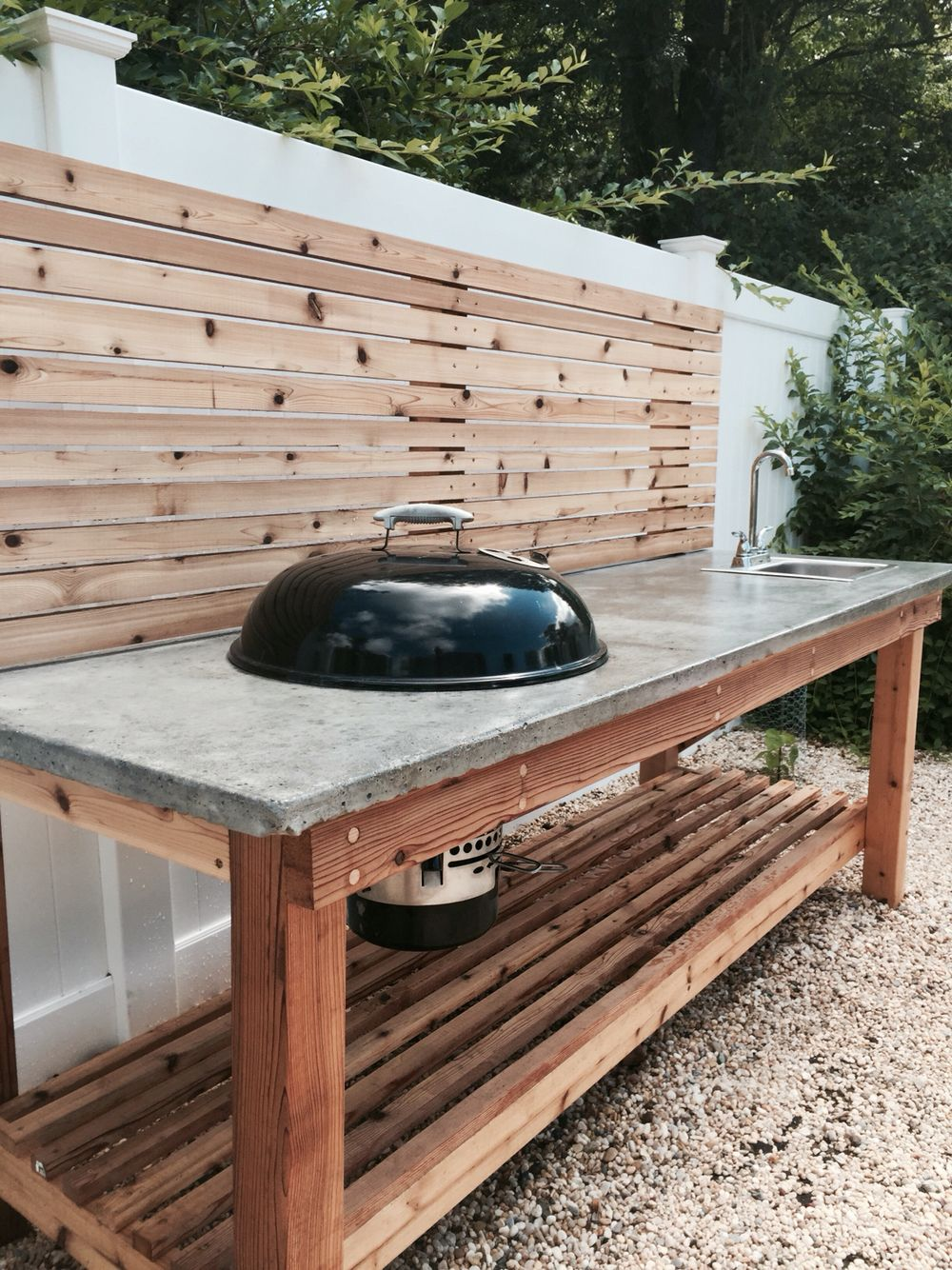cedar wood outdoor kitchen with concrete countertop and built grill side table weber charcoal sink ashley furniture coffee set pier one dinnerware wine liquor cabinets screw legs