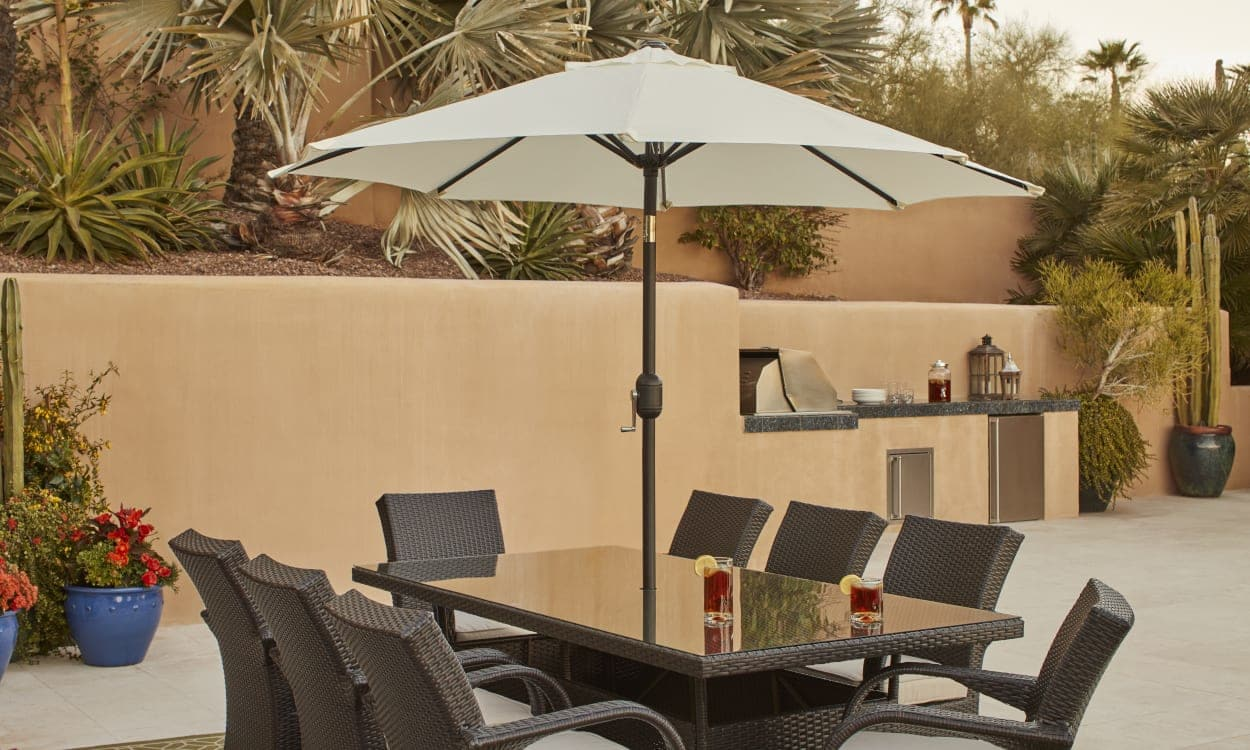 choose the best patio umbrella with these expert tips ing guide weather resistant fabric accent table shading outdoor small round kitchen and chairs set bunnings swing chair