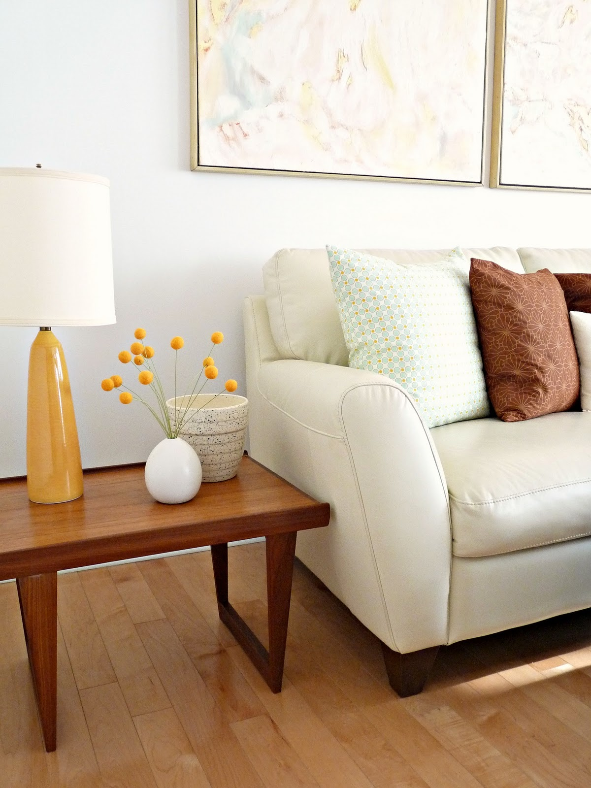 coffee accent tables side for small spaces dark brown polished wood table living room white fabric cushion sofa with base and legs light pastel pale sky blue lines stripes pillow