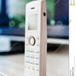 cordless phone office table stock dial white color large display tilt shift lens used accent center and the emphasize attention its small decorative lamps corner side entrance 150x150