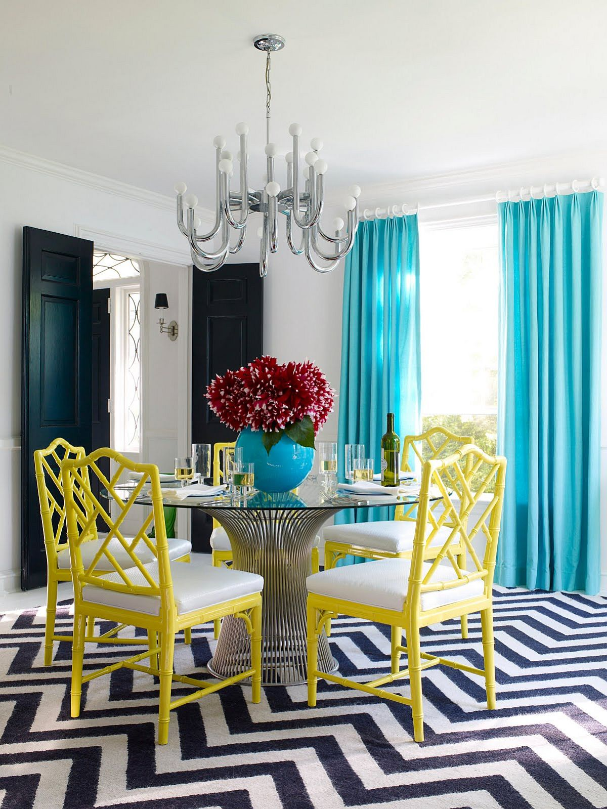 corner dining area gray chairs pineapple monocromatic unique stainless stell chandelier big blue flower vase black door exquisite room with light drapes yellow and snazzy chevron