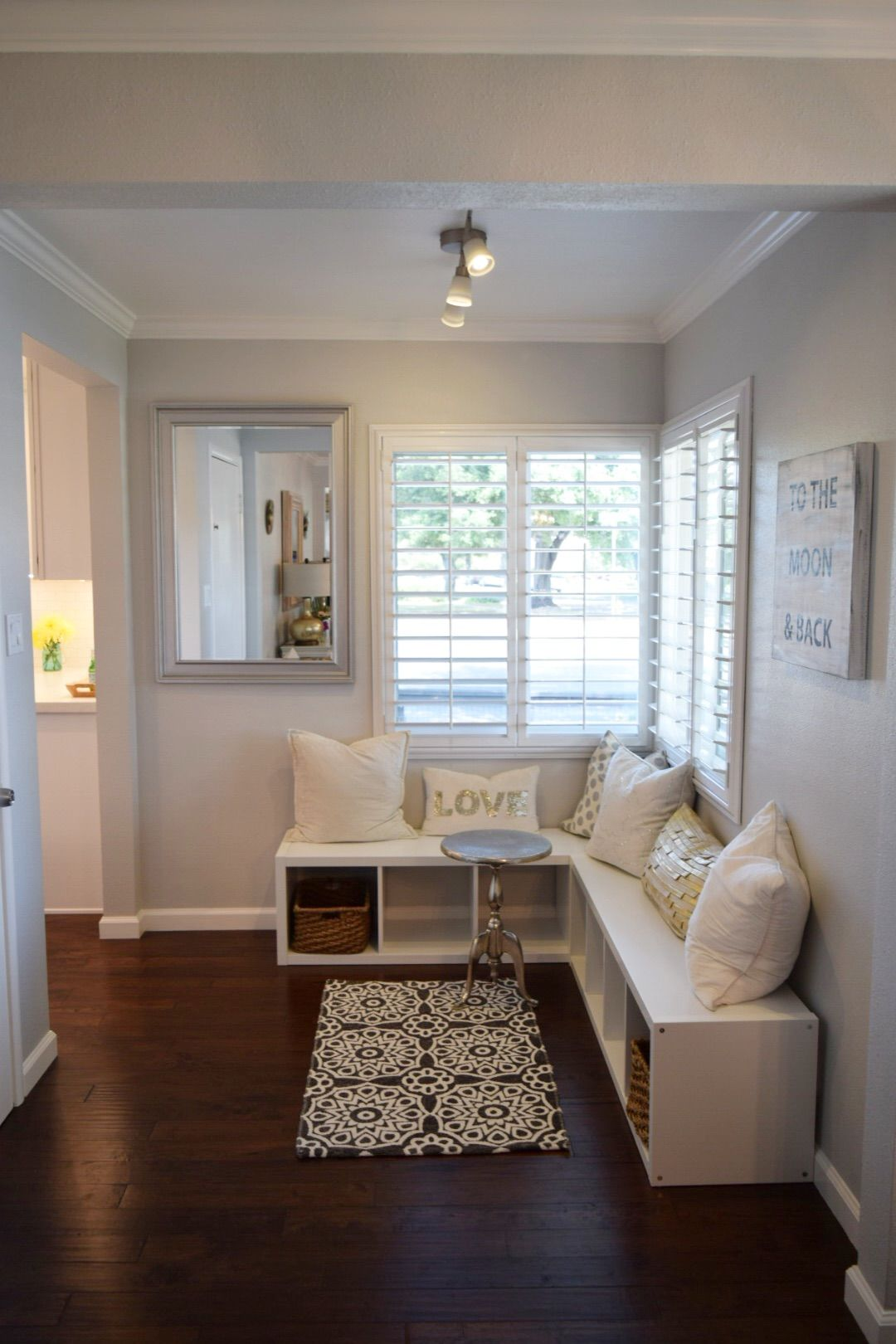 create easy window seating area with pillows for comfort and accent table storage baskets decorative little rug complete the look small round occasional metal floor threshold