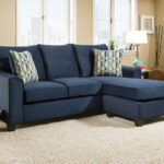 dark blue sectional sofa with accent pillows american freight nile fabric table pier one tables very thin console plastic umbrella waterproof cover for garden and chairs laminated 150x150