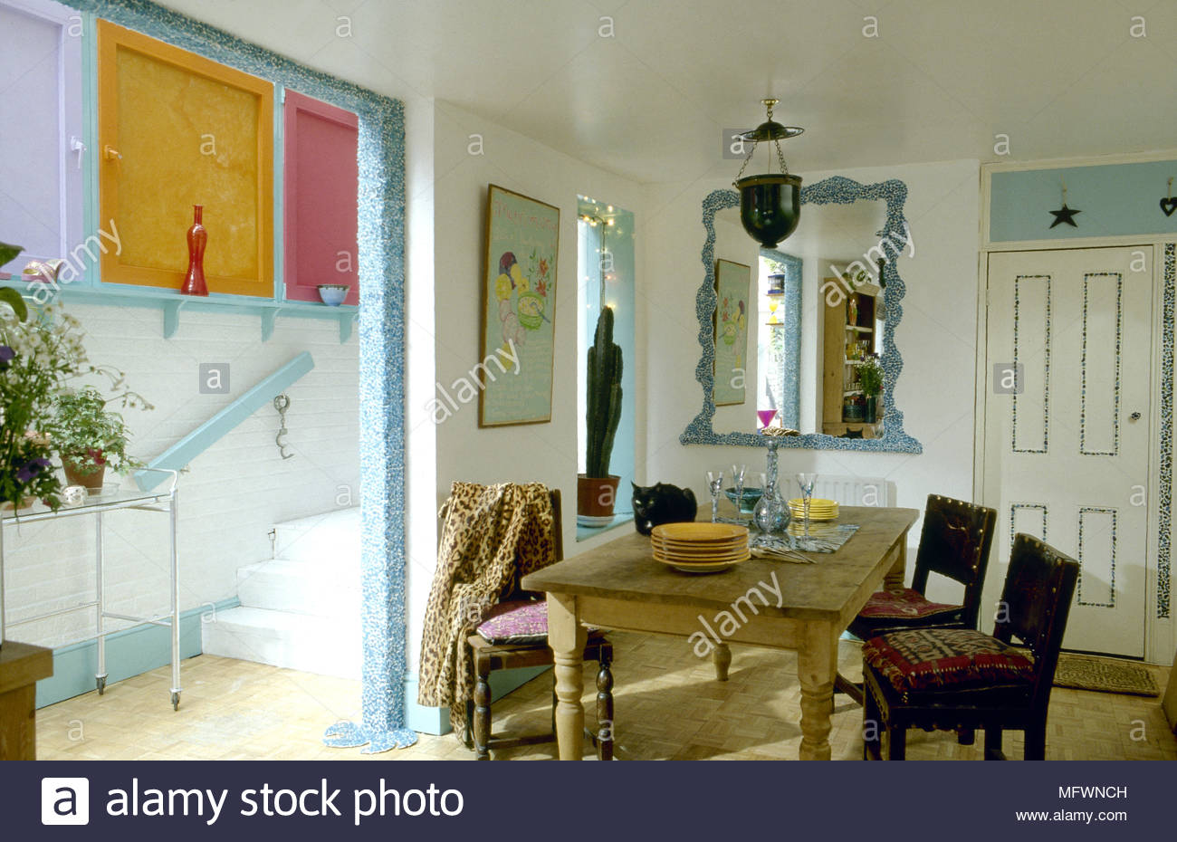 eclectic dining room with decorative paint accents wooden table and chairs doorway adjacent hallway mfwnch living sofa sets high end furniture cabinet doors pier accent corner
