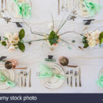 elegant beach themed wedding table setting with mint green napkins kferdf accent and copper mugs scattered seashells stars fishnet runner side decor grey rug target slab dining 150x150