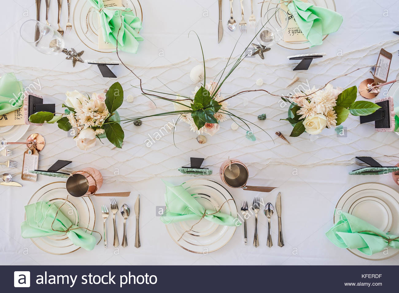 elegant beach themed wedding table setting with mint green napkins kferdf accent and copper mugs scattered seashells stars fishnet runner side decor grey rug target slab dining