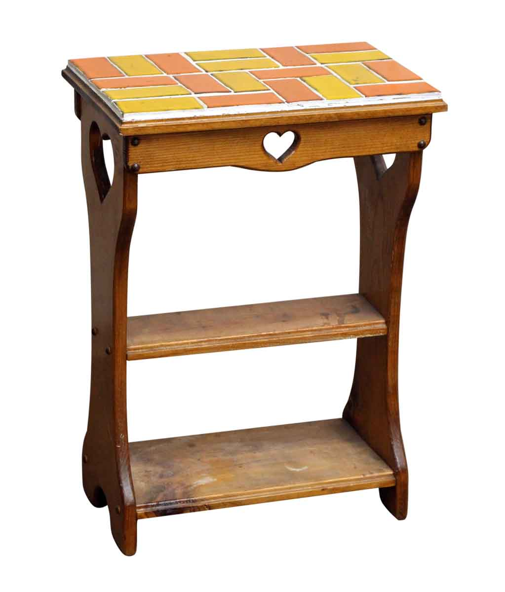end table with heart cut outs and colorful tile top olde ashley accent tables teal colored wedding registry ideas rolling tool cabinet home furniture comfy garden unfinished wood