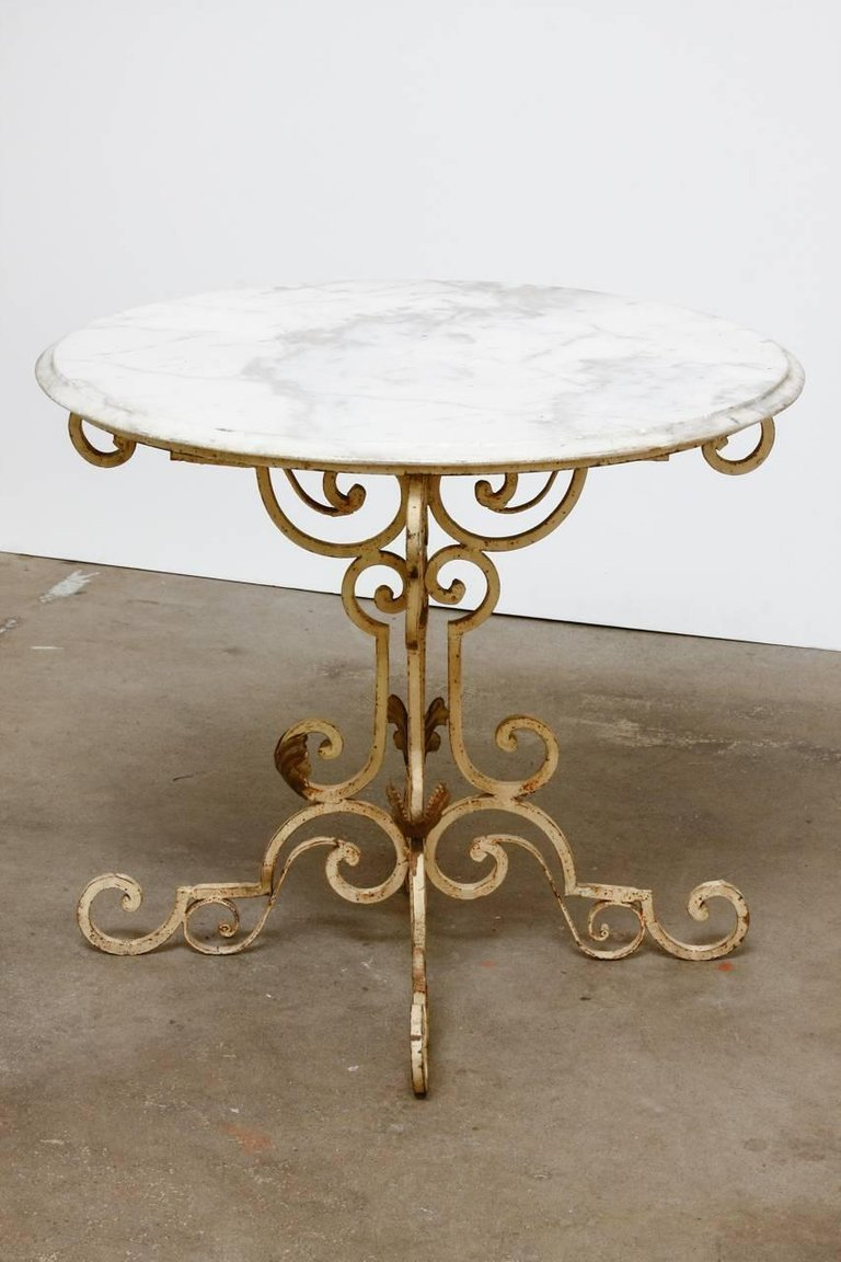 french wrought iron and marble bistro table erin lane estate master accent half round kitchen tall acrylic cherry wood gold decor red patio chairs pottery barn farm tables yellow