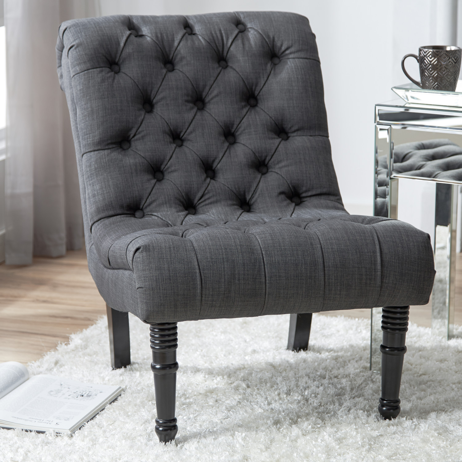 funiture upholsterd accent chairs with arm and high back chair also gray upholstered glossy short black carved legs over white hairy rug laminate floor acrylic table between two