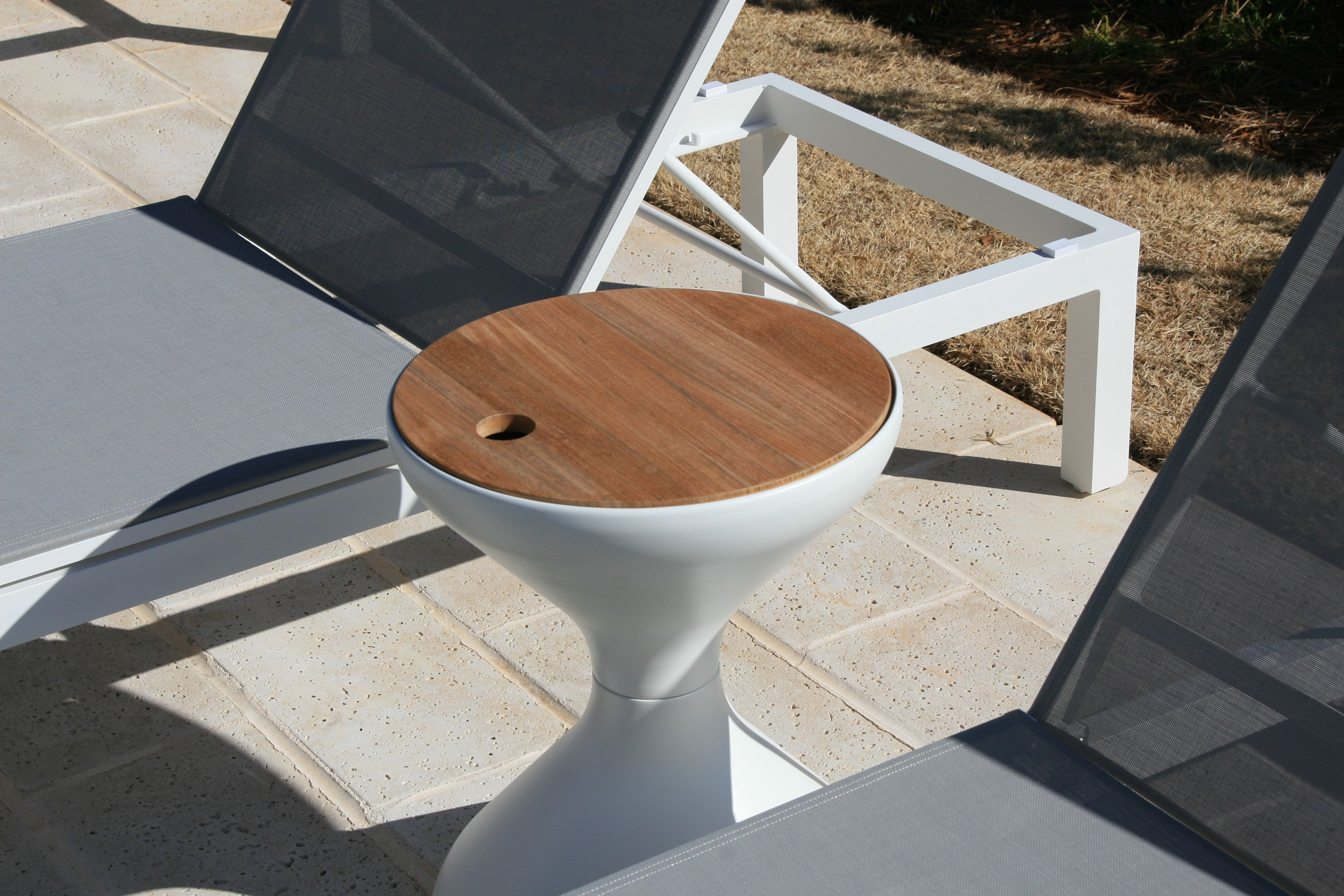 gloster bells side table with ice bucket insert outdoor furniture tables make statement their teak tops and hidden keep your drinks cool dining bench modern nest coffee nut milk