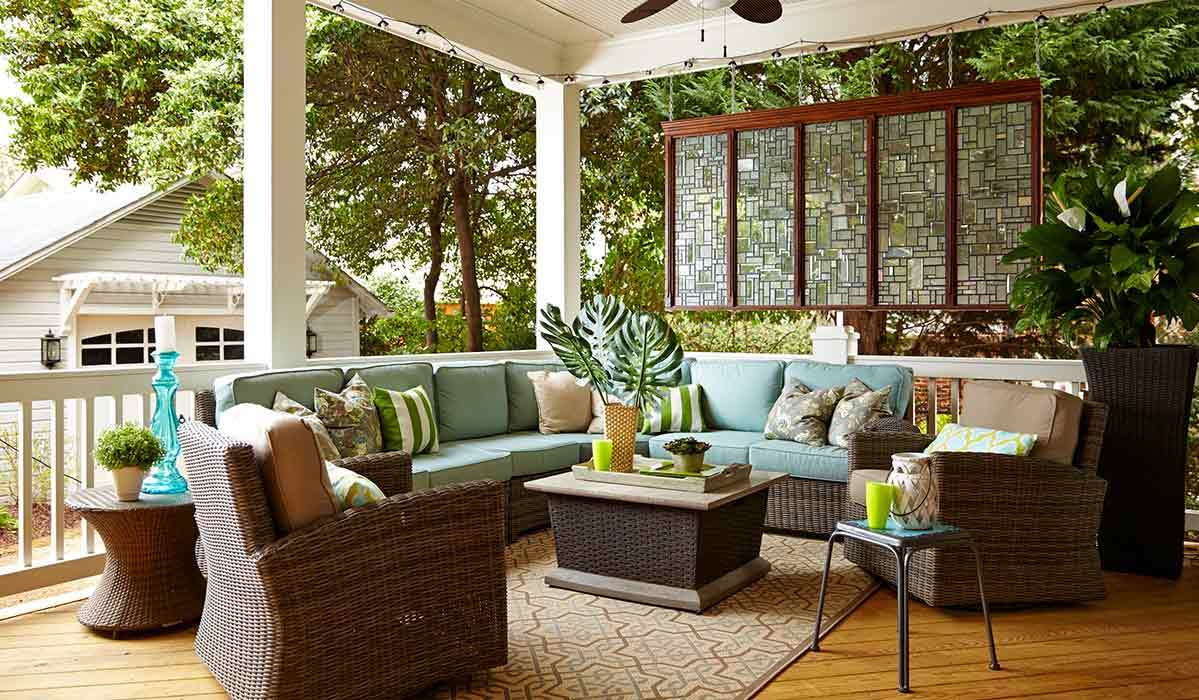 holiday bombay outdoors kauai pineapple accent table antique gold umbrella open the door your outdoor oasis with our favorite patio furniture fireplace chairs setting red runner