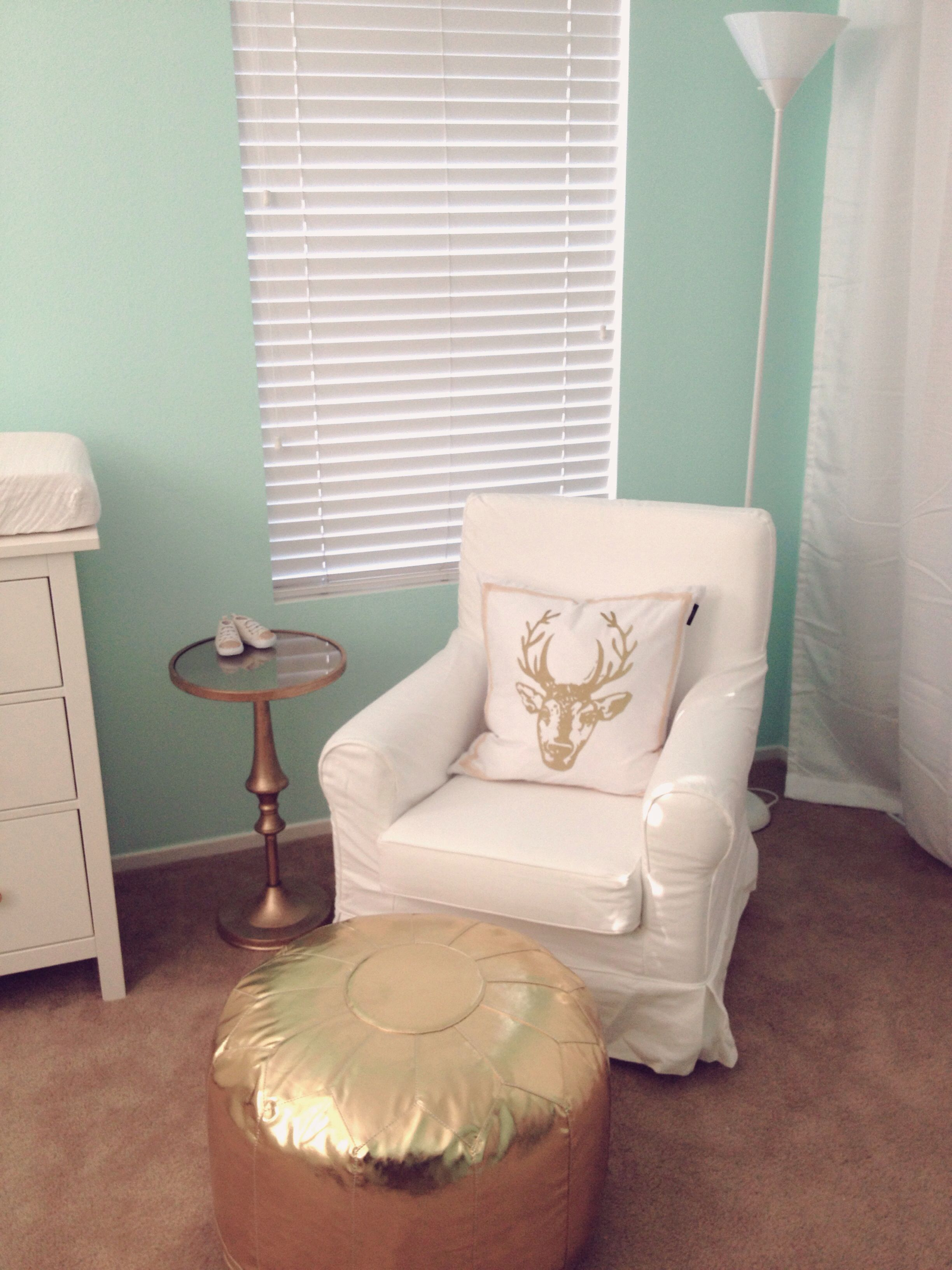 ikea jennylund sofa chair turned into rocker glider gold pouf nursery accent table from land nod pier imports round pedestal entry dining room linens modern chairs drop leaf