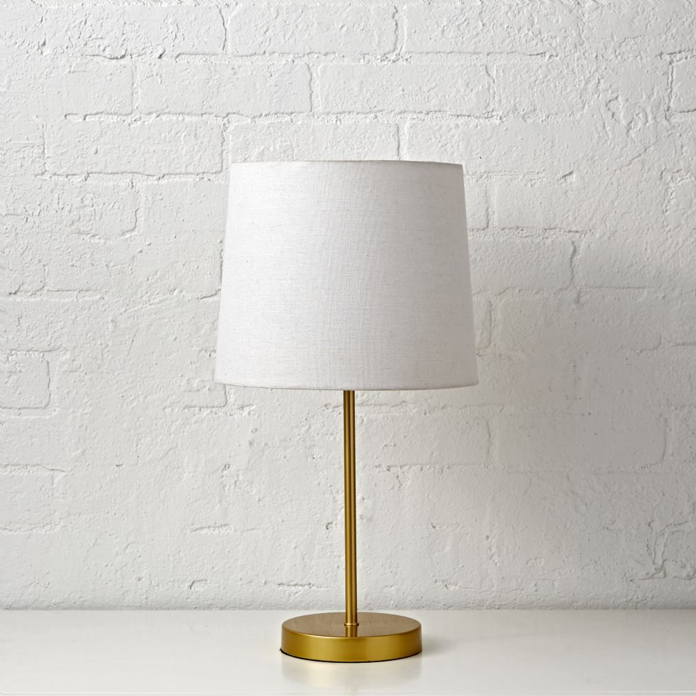 light years gold table lamp the unassuming style this accent lamps helps ensure will around house for many come west elm chandelier tiffany nightstand wine shelf round chair and