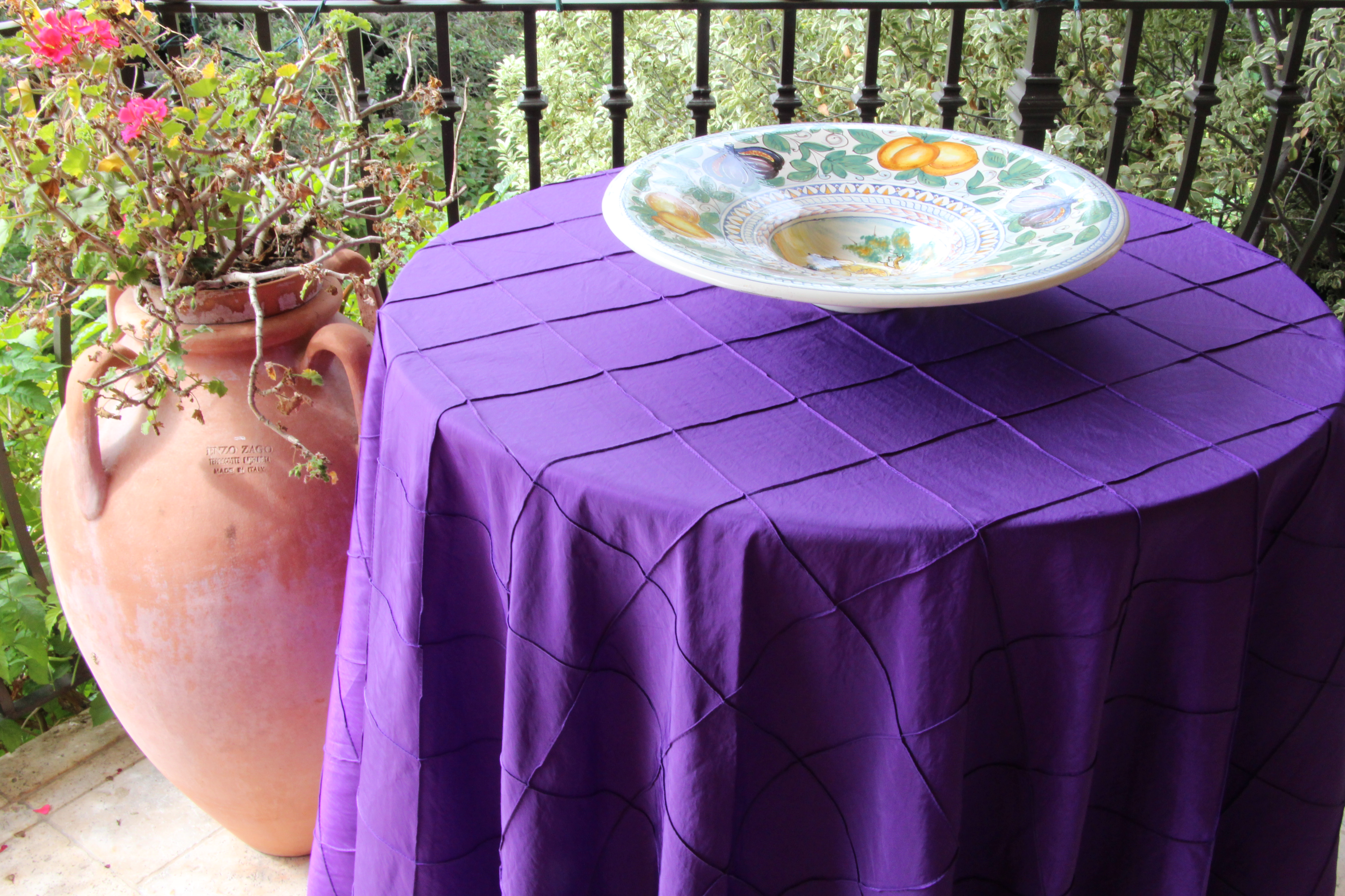 liven any occasion with festive bombay pintuck table linens img accent purple bold and bright option that can used for punch color marble top kitchen set woodard furniture metal