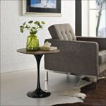 living room mini side table with glass top simple plywood round end grey fabric single tufted sofa white brick stone paint wall wooden laminate flooring green flower vase decor 150x150
