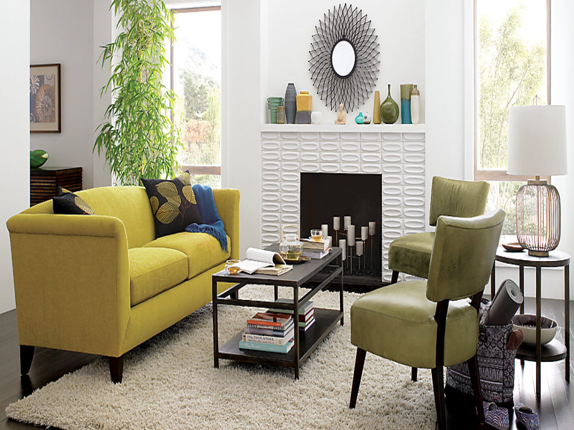 living room yellow fabric loveseat sofa white rug black wood coffee table accent chairs lacquered floor round side lamp fireplace decorative urns bamboo plant accents ideas full