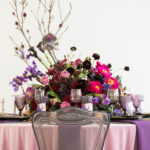 magical styled shoot with unicorns and shades purple nuage fantasy wedding black color palette unicorn magic event ideas accent table clear glassware gold edge mirrored chargers 150x150