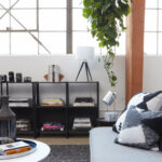 modern yet warm loft with the new project collection emily henderson target masculine neutral accent table retail lighting black glass tables living room concrete outdoor setting 150x150