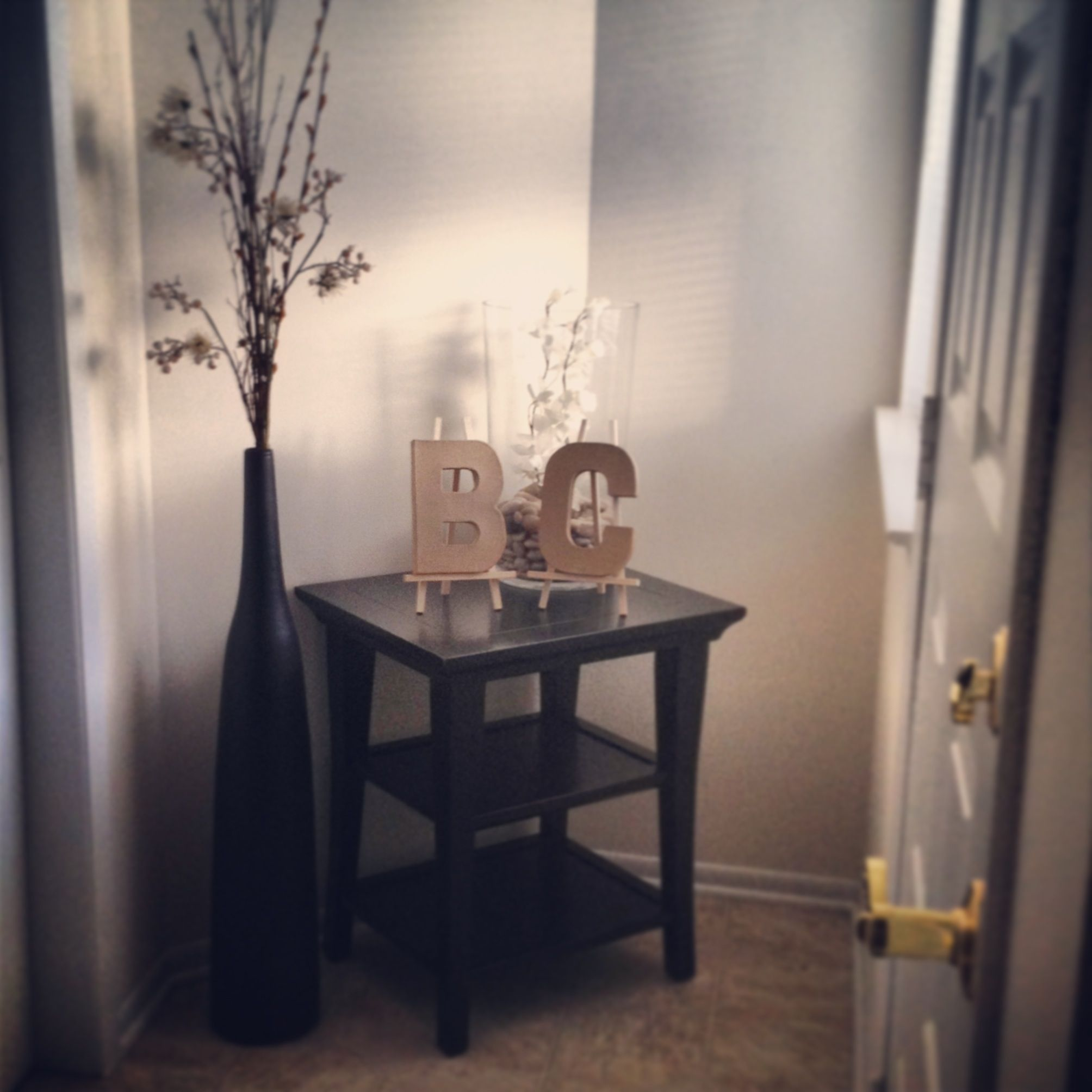 our neutral clean and simple entryway white walls black floor vase gallerie accent table florals pottery barn clear rocks artificial silver side metal living room tables