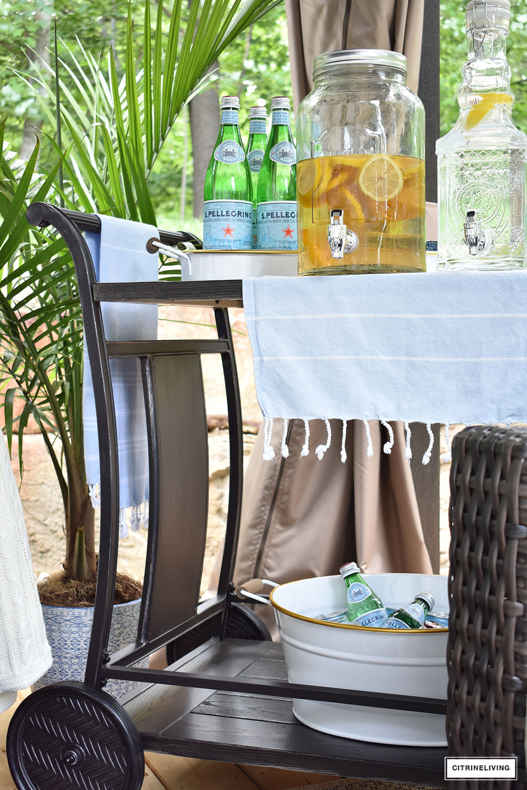 our new backyard patio reveal perfect for entertaining outdoor and canadian tire dashley barcart side table chic bar cart fully stocked guests the essential accessory black