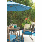 partanna dining table with umbrella option ashley furniture home mood spring haven accent occasional chairs next runner for square homebase patio mid century barn style sliding 150x150