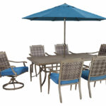 partanna dining table with umbrella option ashley furniture home umb spring haven accent outdoor cocktail hole hand painted brass drum tall side tables living room white drop leaf 150x150