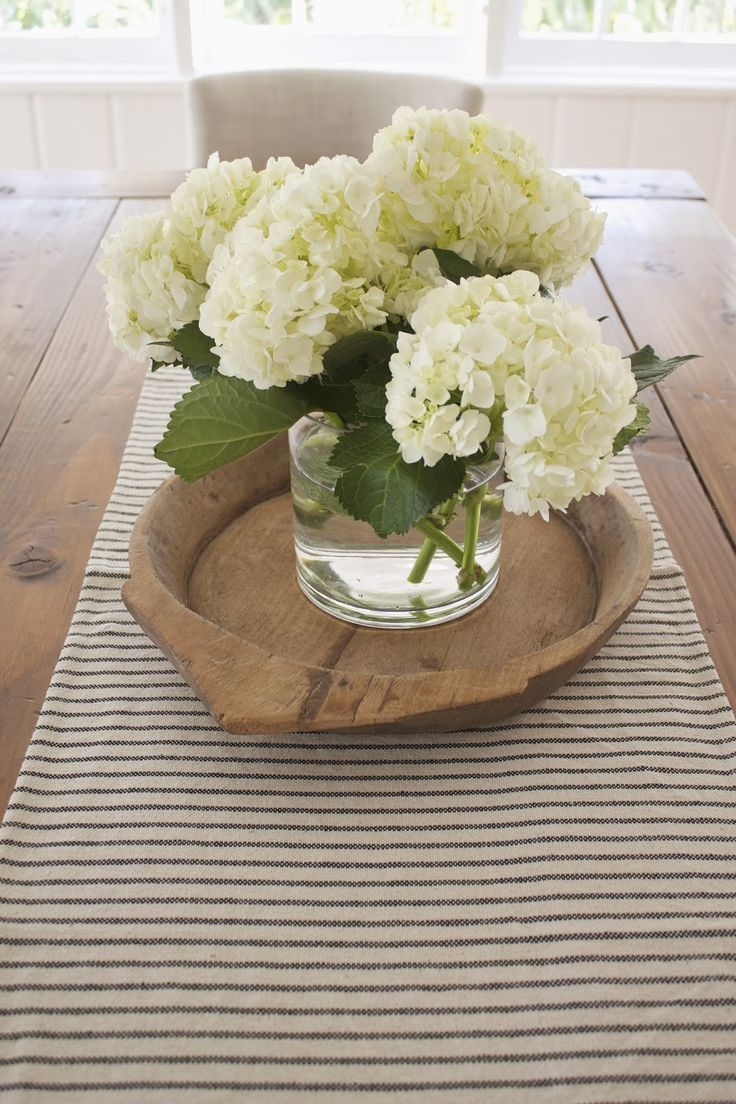pieces farmhouse decor use all around the house wooden serving trays dining table accent fresh florals bedside dresser small round mirror tile patio outdoor furniture concrete