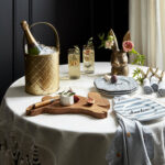 pottery barn unveils whimsical spring collection with fashion duo flower accent table emily current and meritt elliott business wire cordless standing lamp counter height kitchen 150x150