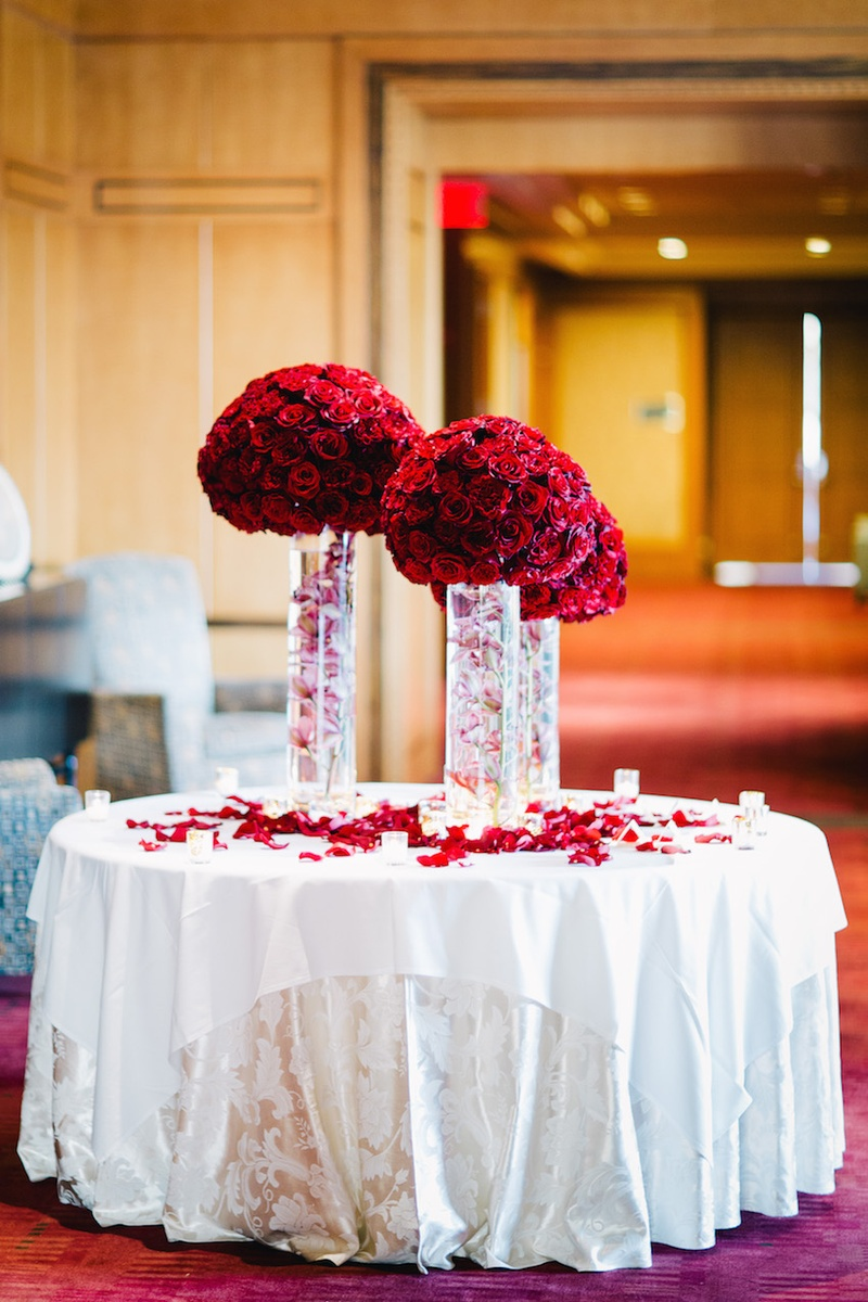 reception decor accent table with red bouquets cloth wedding flowers and submerged pink orchid stems cylinder vases antique round coffee wood marble top lamp contemporary