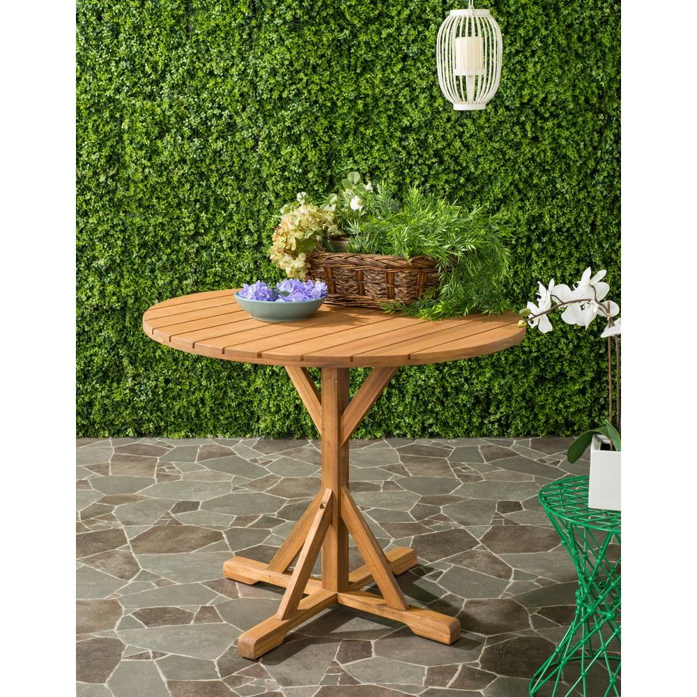 safavieh arcata teak round outdoor patio accent table the side tables silver living room accessories reclining chair meyda tiffany glass tempered coffee with wheels small acrylic
