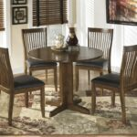 stuman round drop leaf table signature design from small accent brown tablecloth groups slim end black side with drawers ikea and chairs comfortable drum throne terrace umbrella 150x150