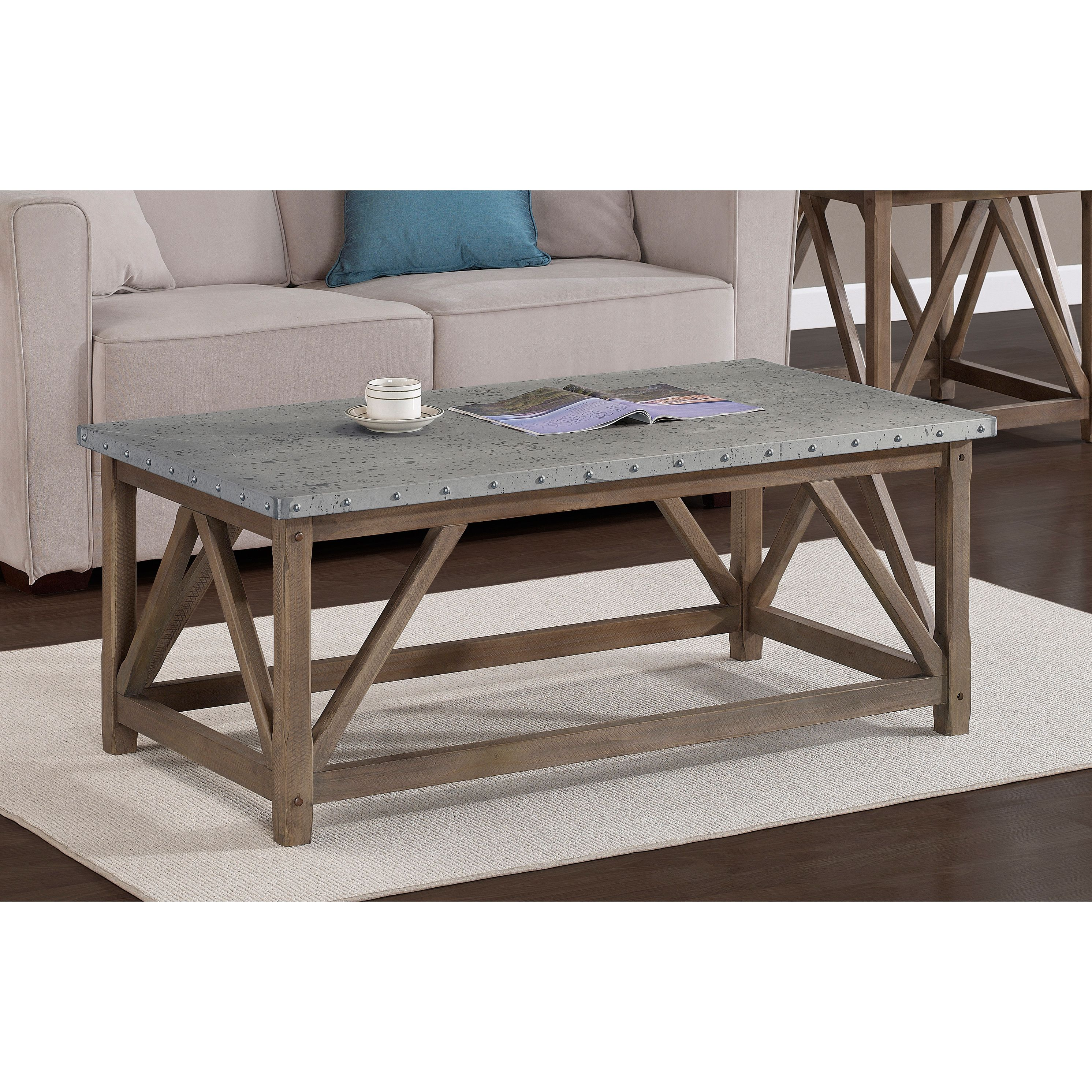 stylish accent your living room with this zinc top wood table coffee the nailhead details give unique look storage cabinets multi colored chest black pottery barn high end tables
