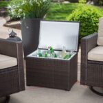 sunset west solana round coffee table wicker outdoor with resin piece patio furniture set chairs and all weather trunk ott umbrella hole glass top small side cabinet brass finish 150x150