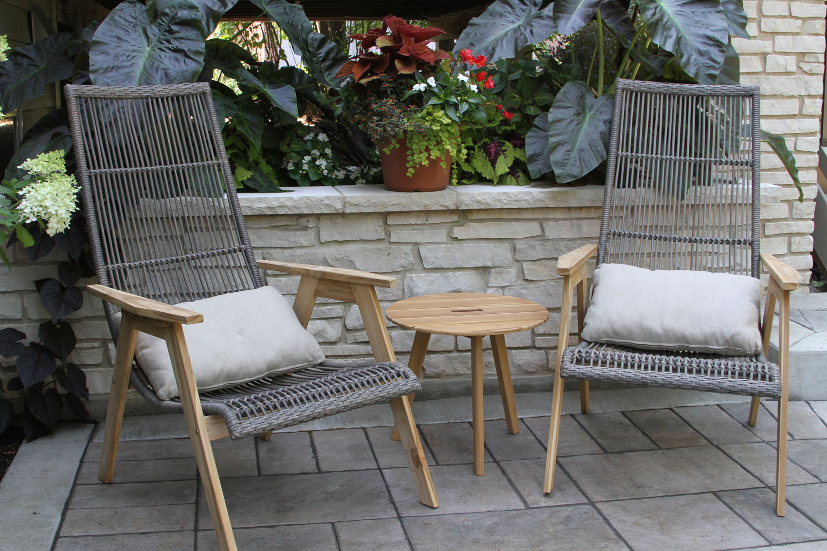 teak wicker furniture collection from outdoor interiors accent table with handle shown basket loungers storage patio lounging tall farmhouse target end tables coffee nate berkus