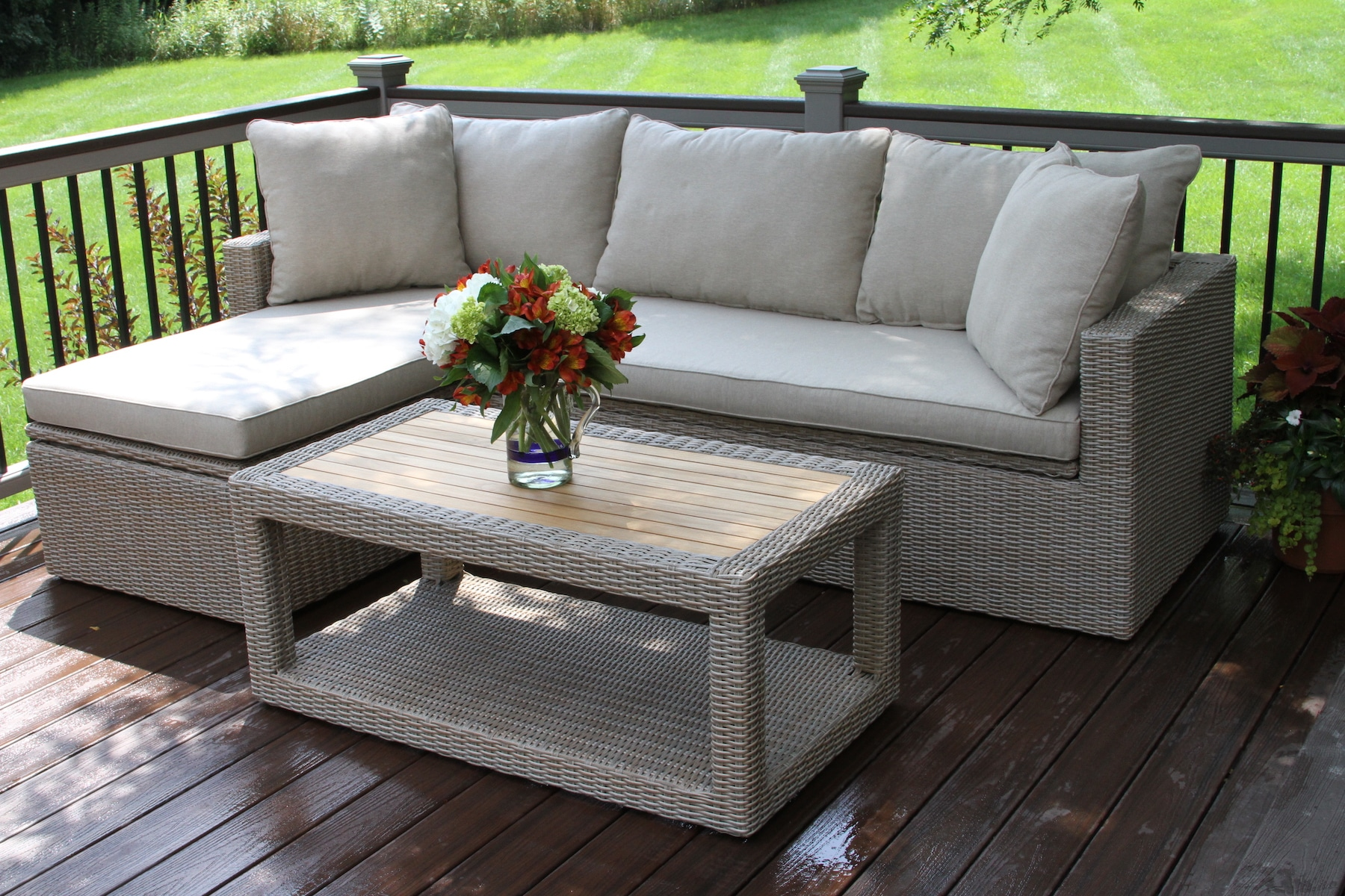 teak wicker furniture collection from outdoor interiors storage accent patio table ash sectional sofa set with waterproof travertine coffee marble console target mosaic top very
