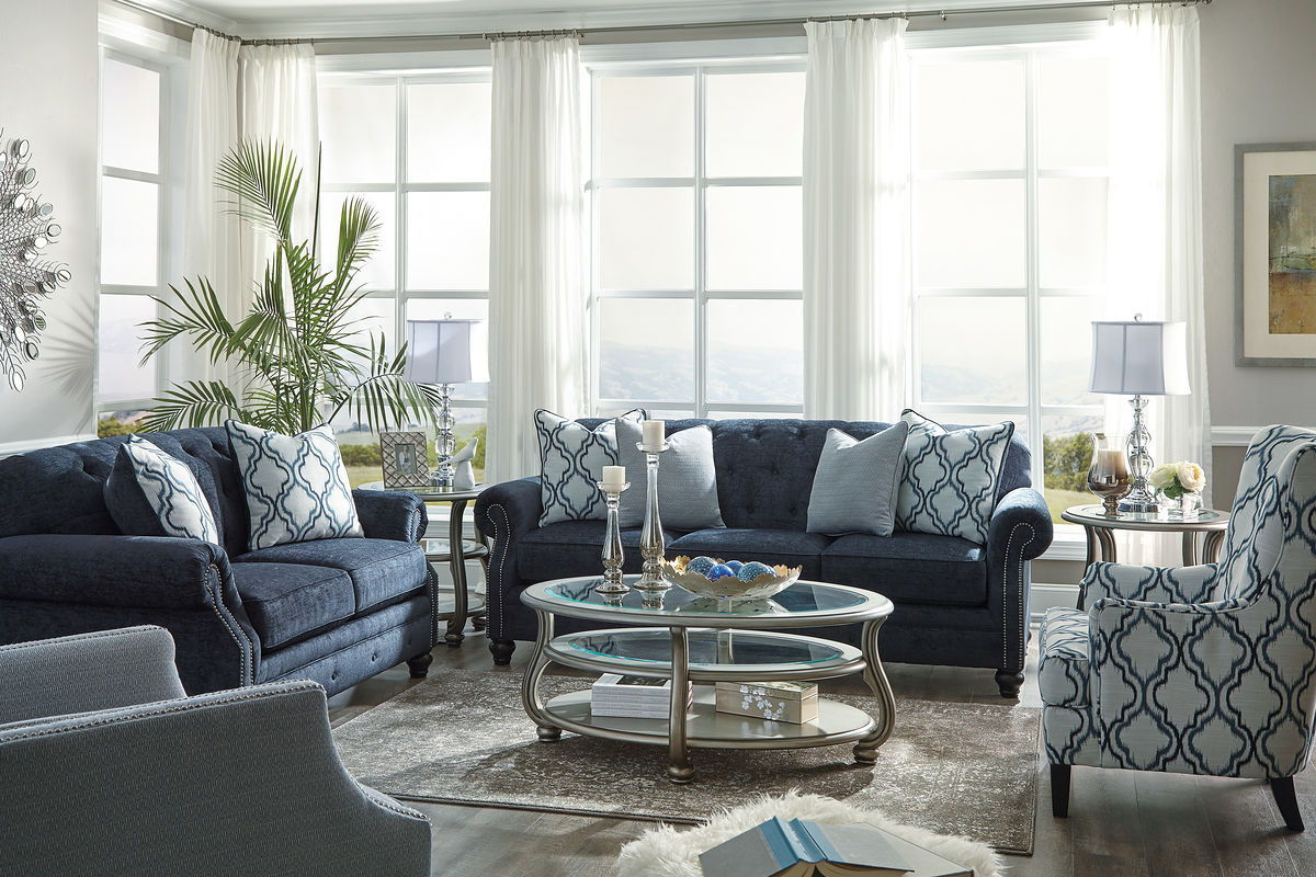 the lavernia navy sofa loveseat accent chairs coralayne cocktail with table end tables solid wood farmhouse dining hairpin legs ikea wicker umbrella battery operated reading light