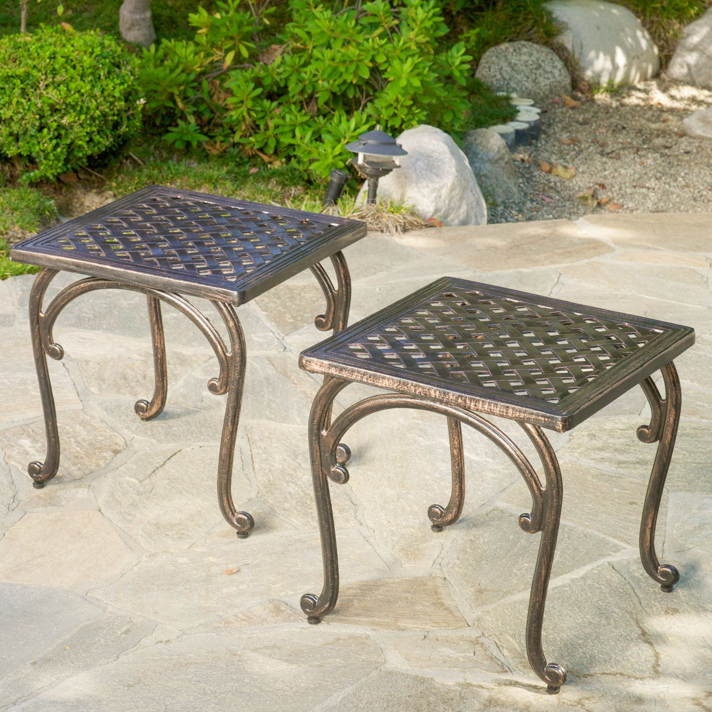 the mckinley cast outdoor end tables are perfect accent pieces metal garden table for your backyard its sturdy construction will give you years enjoyment blue tablecloth faux