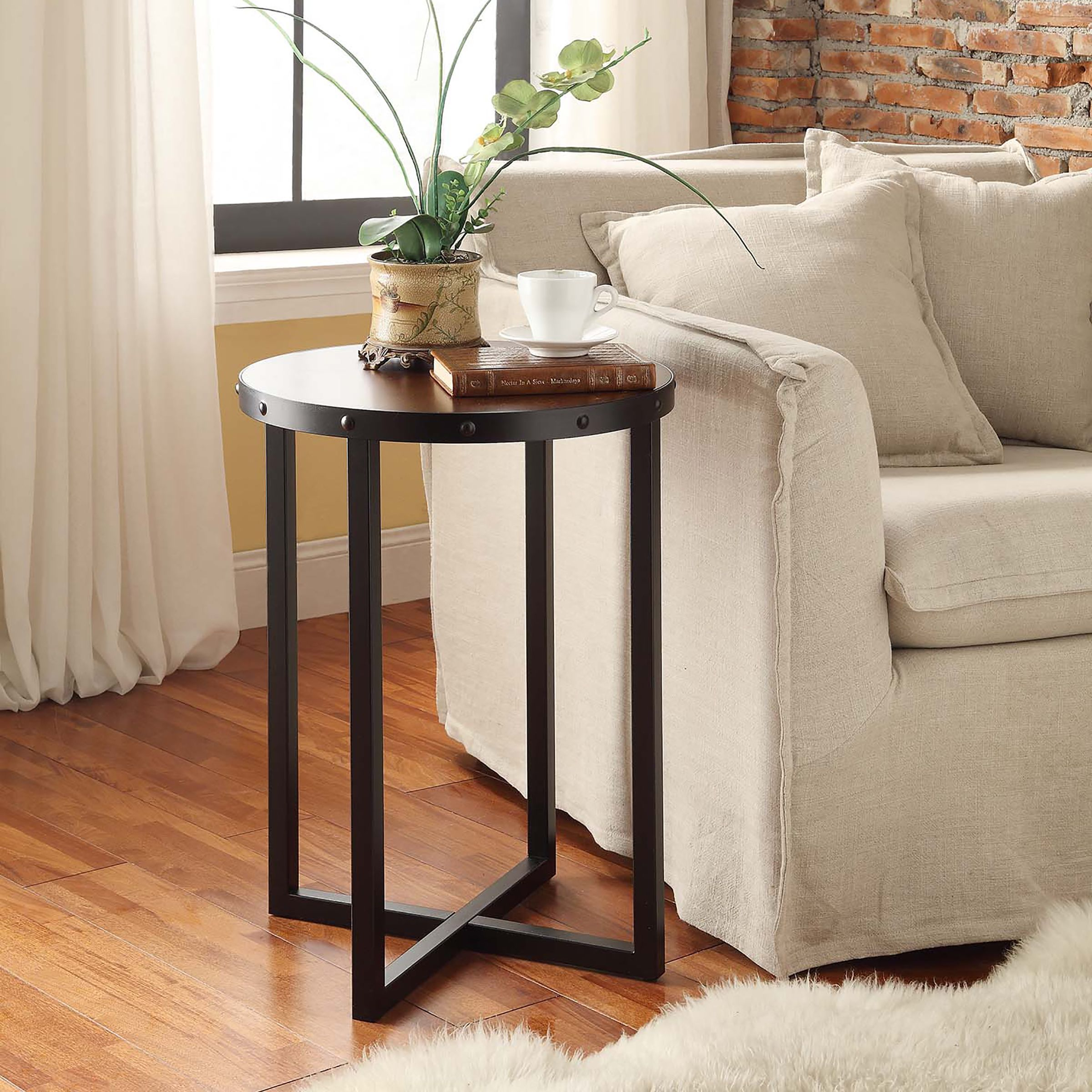 this tall accent table has metal leg construction and chestnut wooden top its round surface supported with squared four way base that offers iron wall clock lawn chair umbrella