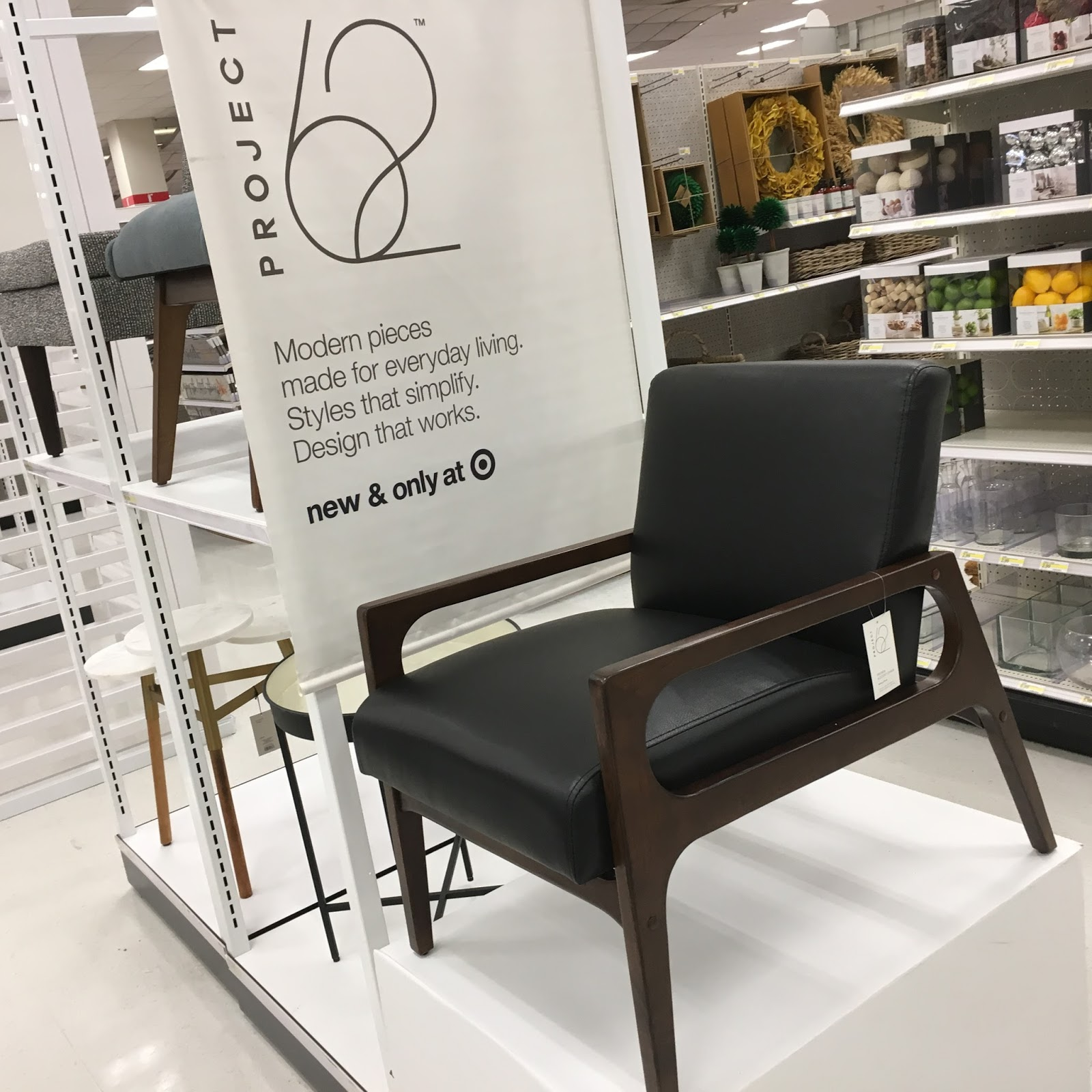 tracy notebook style new target project see home img accent table most locations were given much needed makeover for the brand launch lucite console retail lighting black glass