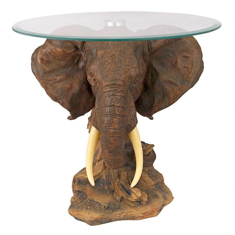 unique furniture round glass top side table african elephant tusk accent animal decor studded dining chairs white coffee set small painted pottery barn floor lamp corner ikea