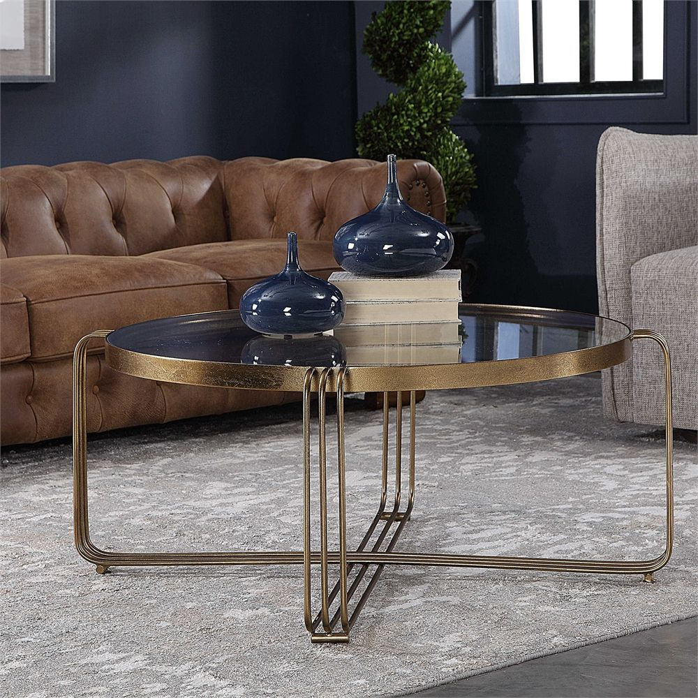 uttermost hilde bronze coffee table tables furniture accent pieces sleek modern shows off clean lines style this striking made hand forged iron with tempered glass top traditional