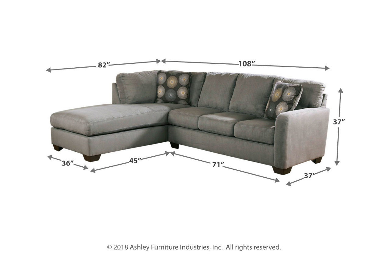 zella piece sectional with chaise ashley furniture home dim clear acrylic accent table slate end tables hampton bay patio set pulaski leather recliner green console modern