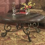ashley furniture rafferty round cocktail table dark brown end tables coffee folding sizes iron accents thomasville good universal curated collection outside high top ethan allen 150x150