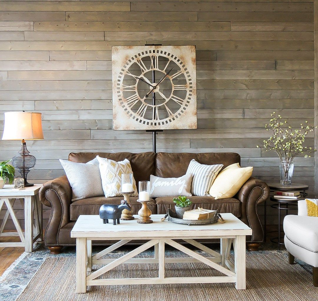 farmhouse living room that will make you want brown sofa what color end tables with couch light and airy look warm white mix textures gray rustic wood wall round glass small table